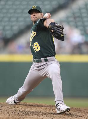 SEATTLE - AUGUST 02:  Starting pitcher Rich Harden #18 of the Oakland Athletics pitches against the Seattle Mariners at Safeco Field on August 2, 2011 in Seattle, Washington. (Photo by Otto Greule Jr/Getty Images)