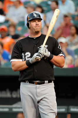 BALTIMORE, MD - AUGUST 10:  Adam Dunn #32 of the Chicago White Sox reacts after striking out against the Baltimore Orioles at Oriole Park at Camden Yards on August 10, 2011 in Baltimore, Maryland.  (Photo by Greg Fiume/Getty Images)