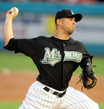 MIAMI GARDENS, FL - AUGUST 13:  Pitcher Javier Vazquez #23 of the Florida Marlins throws against the San Francisco Giants at Sun Life Stadium on August 13, 2011 in Miami Gardens, Florida.  (Photo by Marc Serota/Getty Images)