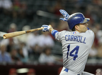 PHOENIX, AZ - AUGUST 07:  Jamey Carroll #14 of the Los Angeles Dodgers bats against the Arizona Diamondbacks during the Major League Baseball game at Chase Field on August 7, 2011 in Phoenix, Arizona. The Diamondbacks defeated the Dodgers 4-3.  (Photo by