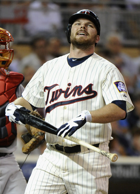 MINNEAPOLIS, MN - AUGUST 9: Jason Kubel #16 of the Minnesota Twins reacts to striking out against the Boston Red Sox in the seventh inning on August 9, 2011 at Target Field in Minneapolis, Minnesota. The Red Sox defeated the Twins 4-3. (Photo by Hannah Fo