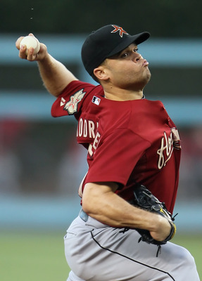 LOS ANGELES, CA - AUGUST 13:  Wandy Rodriguez #51 of the Houston Astros pitches against the Los Angeles Dodgers in the first inning at Dodger Stadium on August 13, 2011 in Los Angeles, California.  (Photo by Jeff Gross/Getty Images)