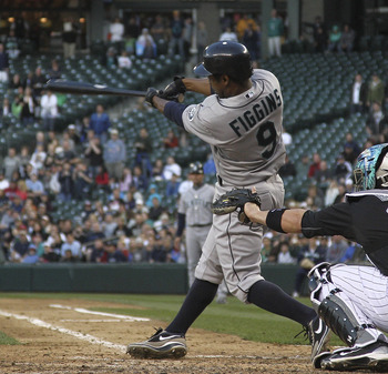 SEATTLE - JUNE 25:  Chone Figgins #9 of the Seattle Mariners hits an RBI sacrifice fly in the seventh inning against the Florida Marlins at Safeco Field on June 25, 2011 in Seattle, Washington. (Photo by Otto Greule Jr/Getty Images)