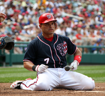 WASHINGTON, DC - JULY 04: Ivan Rodriguez #7 of the Washington Nationals kneels on the ground after an inside pitch against the Chicago Cubs at Nationals Park on July 4, 2011 in Washington, DC. The Washington Nationals won 5-4. (Photo by Ned Dishman/Getty