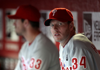 PHOENIX, AZ - APRIL 26:  Pitcher Roy Halladay #34 (R) and Cliff Lee #33 of the Philadelphia Phillies sit in the dugout during the Major League Baseball game against the Arizona Diamondbacks at Chase Field on April 26, 2011 in Phoenix, Arizona.  (Photo by
