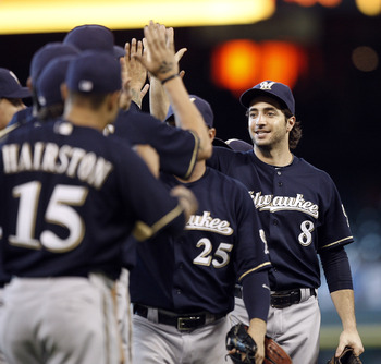 HOUSTON - AUGUST 07:  Ryan Braun #8 of the Milwaukee Brewers celebrates with this teammates after sweeping the Astros with a 7-3 win at Minute Maid Park on August 7, 2011 in Houston, Texas.  (Photo by Bob Levey/Getty Images)