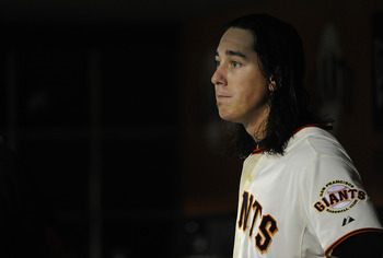 SAN FRANCISCO, CA - AUGUST 2: Tim Lincecum #55 of the San Francisco Giants looks on from the dugout against the Arizona Diamondbacks in the seventh inning during an MLB baseball game at AT&T Park August 2, 2011 in San Francisco, California. (Photo by Thea