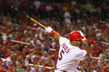 ST. LOUIS, MO - AUGUST 12: Albert Pujols #5 of the St. Louis Cardinals hits an RBI single against the Colorado Rockies at Busch Stadium on August 12, 2011 in St. Louis, Missouri.  The Cardinals beat the Rockies 6-1.  (Photo by Dilip Vishwanat/Getty Images