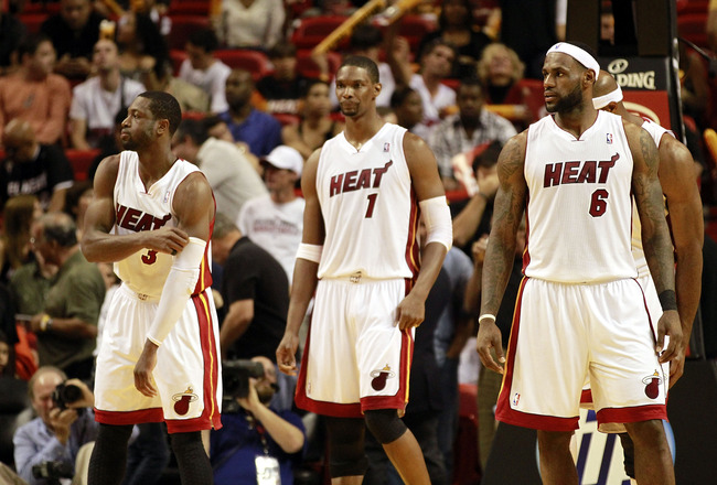 MIAMI, FL - MARCH 25:  Forward Chris Bosh #1, Forward LeBron James #6 and Guard Dwyane Wade #3 of the Miami Heat against the Philadelphia 76ers at American Airlines Arena on March 25, 2011 in Miami, Florida. The Heat defeated the Sixers 111-99. NOTE TO US