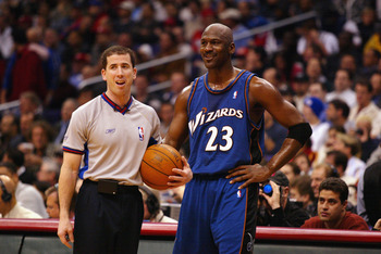 LOS ANGELES - FEBRUARY 12:  Michael Jordan #23 of the Washington Wizards talks with referee Tim Donaghy during the game against the Los Angeles Clippers on February 12, 2003 at Staples Center in Los Angeles, California.  The Wizards won 108-104.  NOTE TO