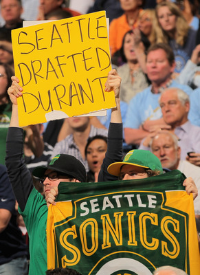 DENVER, CO - APRIL 23:  Seattle Sonics fans display signs as the support the Denver Nuggets against the Oklahoma City Thunder in Game Three of the Western Conference Quarterfinals in the 2011 NBA Playoffs on April 23, 2011 at the Pepsi Center in Denver, C