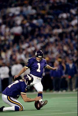 20 Dec 1998: Kicker Gary Anderson #1 of the Minnesota Vikings with the help of Mitch Berger kicks his 35th consecutive field goal during the game against the Jacksonville Jaguars at the Hubert H. Humphrey Metrodome in Minneapolis, Minnesota. The Vikings d