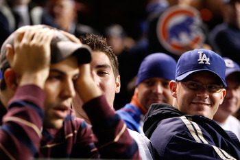 CHICAGO - OCTOBER 02:  Brian Engler (R), a fan of the Los Angeles Dodgers looks towars a dejected Michael Piper (L), a fan of the Chicago Cubs in Game Two of the NLDS during the 2008 MLB Playoffs at Wrigley Field on October 2, 2008 in Chicago, Illinois. T
