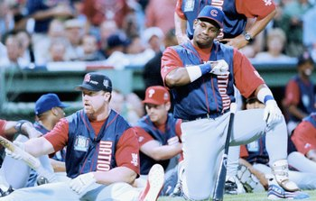 BOSTON - JULY 12:  Sammy Sosa of the National League looks on along with Mark McGwire during the 1999 MLB Homerun Derby on July 12, 1999 at Fenway Park in Boston, Massachusetts.  (Photo by: Brian Bahr/Getty Images)
