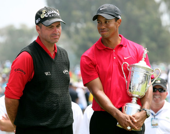SAN DIEGO - JUNE 16:  Tiger Woods stands with runner-up Rocco Mediate after winning on the first sudden death playoff hole during the playoff round of the 108th U.S. Open at the Torrey Pines Golf Course (South Course) on June 16, 2008 in San Diego, Califo