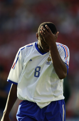 INCHEON - JUNE 11:  Despair for Marcel Desailly of France as they crash out of the finals after the FIFA World Cup Finals 2002 Group A match between Denmark and France played at the Incheon Munhak Stadium, in Incheon, South Korea on June 11, 2002. Denmark