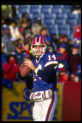 2 Dec 1990: Quarterback Frank Reich of the Buffalo Bills looks to pass the ball during a game against the Philadelphia Eagles at Rich Stadium in Orchard Park, New York. The Bills won the game, 30-23.