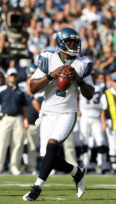 SAN DIEGO, CA - AUGUST 11:  Quarterback Tarvaris Jackson #7 of  the Seattle Seahawks rolls back in the pocket against  the San Diego Chargers during their  NFL preseason game on August 11, 2011 at Qualcomm Stadium in San Diego, California. (Photo by Donal