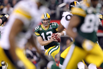 ARLINGTON, TX - FEBRUARY 06:  Aaron Rodgers #12 of the Green Bay Packers looks to pass against the Pittsburgh Steelers during Super Bowl XLV at Cowboys Stadium on February 6, 2011 in Arlington, Texas. The Packers won 31-25.  (Photo by Jamie Squire/Getty I