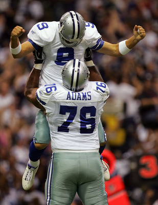 DALLAS - SEPTEMBER 15:  Quarterback Tony Romo #9 of the Dallas Cowboys celebrates a touchdown pass with Flozell Adams #76 against the Philadelphia Eagles in the first quarter at Texas Stadium on September 15, 2008 in Irving, Texas.  (Photo by Ronald Marti