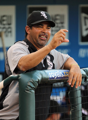 KANSAS CITY, MO - JULY 18:  Manager Ozzie Guillen #13 of the Chicago White Sox watches from the dugout prior to the start of the game against the Kansas City Royals on July 18, 2011 at Kauffman Stadium in Kansas City, Missouri.  (Photo by Jamie Squire/Get