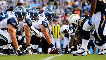 SAN DIEGO, CA - AUGUST 11: Center Mike Gibson #64 of the Seattle Seahawks lines up against the San Diego Chargers defensive line during the NFL preseason game at Qualcomm Stadium on August 11, 2011 in San Diego, California.  (Photo by Kevork Djansezian/Ge