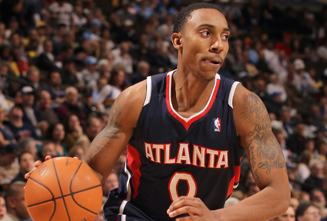 DENVER, CO - FEBRUARY 28:  Jeff Teague #0 of the Atlanta Hawks controls the ball against the Denver Nuggets during NBA action at the Pepsi Center on February 28, 2011 in Denver, Colorado. The Nuggets deafeated the Hawks 100-90. NOTE TO USER: User expressl