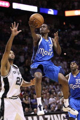 SAN ANTONIO - APRIL 23:  Guard Rodrigue Beaubois #3 of the Dallas Mavericks takes a shot against Tim Duncan #21 of the San Antonio Spurs in Game Three of the Western Conference Quarterfinals during the 2010 NBA Playoffs at AT&amp;T Center on April 23, 2010 in