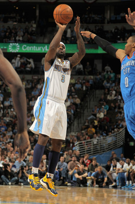 DENVER, CO - APRIL 25:  Ty Lawson #3 of the Denver Nuggets takes a shot against Russell Westbrook #0 of the Oklahoma City Thunder in Game Four of the Western Conference Quarterfinals in the 2011 NBA Playoffs on April 24, 2011 at the Pepsi Center in Denver