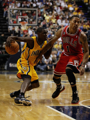 INDIANAPOLIS, IN - APRIL 23: Darren Collison #2 of the Indiana Pacers moves against Derrick Rose #1 of the Chicago Bulls in Game Four of the Eastern Conference Quarterfinals in the 2011 NBA Playoffs at Conseco Fieldhouse on April 23, 2011 in Indianapolis,
