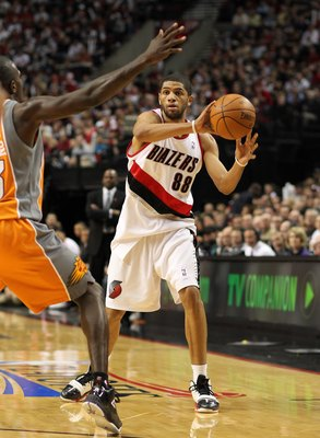 PORTLAND, OR - APRIL 24:  Nicolas Batum #88 of the Portland Trail Blazers passes against Jason Richardson #23 of the Phoenix Suns during Game Four of the Western Conference Quarterfinals of the NBA Playoffs on April 24, 2010 at the Rose Garden in Portland