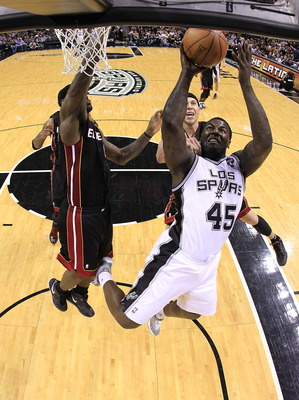 SAN ANTONIO, TX - MARCH 04:  Forward DeJuan Blair #45 of the San Antonio Spurs takes a shot against Mike Bibby #0 of the Miami Heat at AT&amp;T Center on March 4, 2011 in San Antonio, Texas.   NOTE TO USER: User expressly acknowledges and agrees that, by down