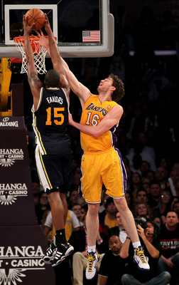 LOS ANGELES, CA - APRIL 05:  Pau Gasol #16 of the Los Angeles Lakers blocks a shot by Derrick Favors #15 of the Utah Jazz at Staples Center on April 5, 2011 in Los Angeles, California. The Jazz won 86-85.  NOTE TO USER: User expressly acknowledges and agr