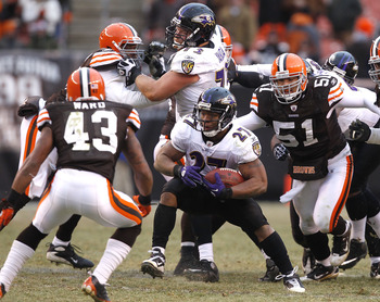 CLEVELAND - DECEMBER 26:  Running back Ray Rice #27 of the Baltimore Ravens runs by defenders T.J. Ward #43 and Chris Gocong #51 of the Cleveland Browns at Cleveland Browns Stadium on December 26, 2010 in Cleveland, Ohio.  (Photo by Matt Sullivan/Getty Im
