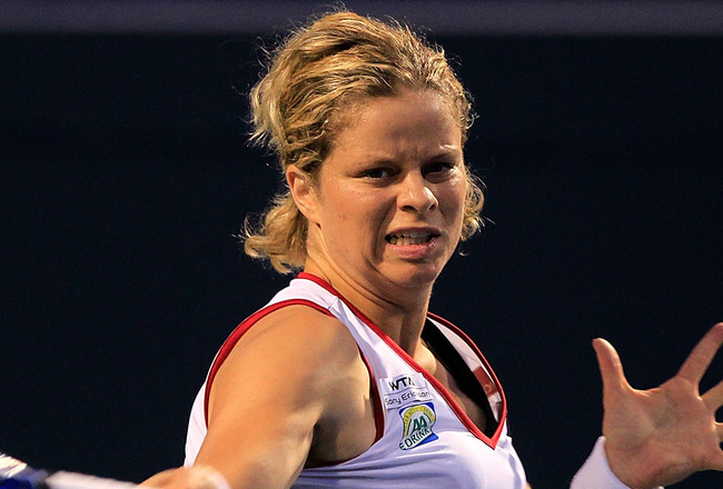 TORONTO, ON - AUGUST 09:  Kim Clijsters of Belgium returns to Jie Zheng of China on Day 2 of the Rogers Cup presented by National Bank at the Rexall Centre on August 9, 2011 in Toronto, Ontario, Canada.  (Photo by Chris Trotman/Getty Images)