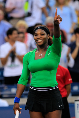 TORONTO, ON - AUGUST 13:  Serena Williams reacts to winning her match with Victoria Azarenka of Belarus on Day 6 of the Rogers Cup presented by National Bank at the Rexall Centre on August 13, 2011 in Toronto, Ontario, Canada.  (Photo by Chris Trotman/Get