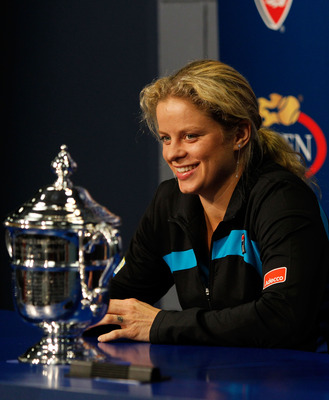 NEW YORK - SEPTEMBER 11:  Kim Clijsters of Belguim talks to the media with the trophy after defeating Vera Zvonareva of Russia during their women's singles final on day thirteen of the 2010 U.S. Open at the USTA Billie Jean King National Tennis Center on