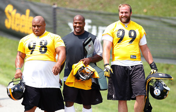 LATROBE, PA - JULY 29: Casey Hampton #98, James Harrison #92, and Brett Keisel #99 of the Pittsburgh Steelers walk down to the field during training camp on July 29, 2011 at St Vincent College in Latrobe, Pennsylvania.  (Photo by Jared Wickerham/Getty Ima