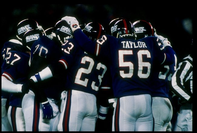 11 Jan 1987: Linebacker Lawrence Taylor of the New York Giants huddles with his team during the NFC Championship game against the Washington Redskins in Giants Stadium at the Meadowlands in East Rutherford, New Jersey. The Giants won the game 17-0.