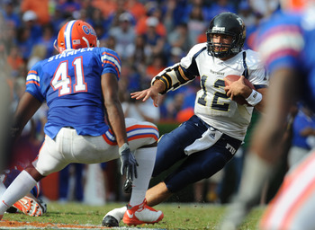 GAINESVILLE, FL - NOVEMBER 21: Quarterback Paul McCall #12 of  the Florida International University Golden Panthers rushes for a gain  against the Florida Gators, November 21, 2009 at Ben Hill Griffin Stadium in Gainesville, Florida.  (Photo by Al Messers