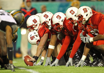ORLANDO, FL - DECEMBER 28:  The North Carolina State Wolfpack snap the ball during the Champs Sports Bowl against the West Virginia Mountineers at Florida Citrus Bowl Stadium on December 28, 2010 in Orlando, Florida.  (Photo by Mike Ehrmann/Getty Images)