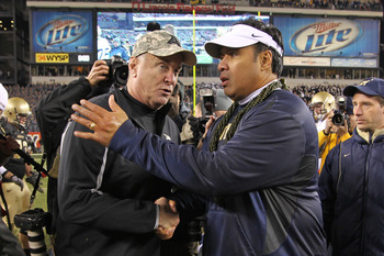 PHILADELPHIA - DECEMBER 11: Head coach Rich Ellerson of the Army Black Knights (L) shakes hands with head coach Ken Niumatalolo of the Navy Midshipmen after a game on December 11, 2010 at Lincoln Financial Field in Philadelphia, Pennsylvania. The Midshipm
