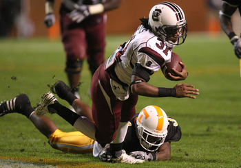 KNOXVILLE, TN - OCTOBER 31:  Kenny Miles #31 of the South Carolina Gamecocks goes down with the ball against the Tennessee Volunteers at Neyland Stadium on October 31, 2009 in Knoxville, Tennessee.  (Photo by Streeter Lecka/Getty Images)