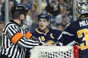BUFFALO, NY - APRIL 14:  Captain Daniel Briere #48 of the Buffalo Sabres talks to an NHL on-ice official during a break in game action the New York Islanders during Game 2 of the 2007 NHL Eastern Conference Quarterfinals on April 14, 2007 at HSBC Arena in