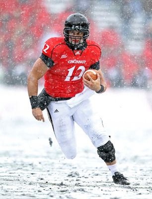 CINCINNATI, OH - DECEMBER 04:  Zach Collaros #12 of the Cincinnati Bearcats runs with the ball  during the Big East Conference game against the Pittsburgh Panthers at Nippert Stadium on December 4, 2010 in Cincinnati, Ohio. Pittsburgh won 28-10.  (Photo b