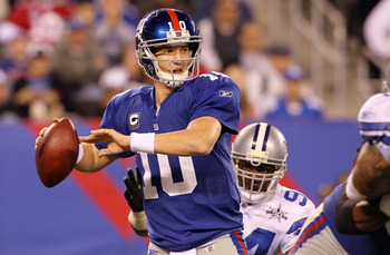 EAST RUTHERFORD, NJ - NOVEMBER 14:  Eli Manning #10 of the New York Giants throws a pass against the Dallas Cowboys on November 14, 2010 at the New Meadowlands Stadium in East Rutherford, New Jersey.  (Photo by Jim McIsaac/Getty Images)