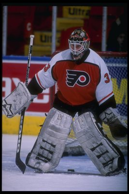 31 Jan 1995:  Goaltender Dominic Roussel of the Philadelphia Flyers looks on during a game against the Quebec Nordiques at the Quebec Coliseum in Quebec City, Quebec.  The Nordiques won the game, 5-2. Mandatory Credit: Robert Laberge  /Allsport