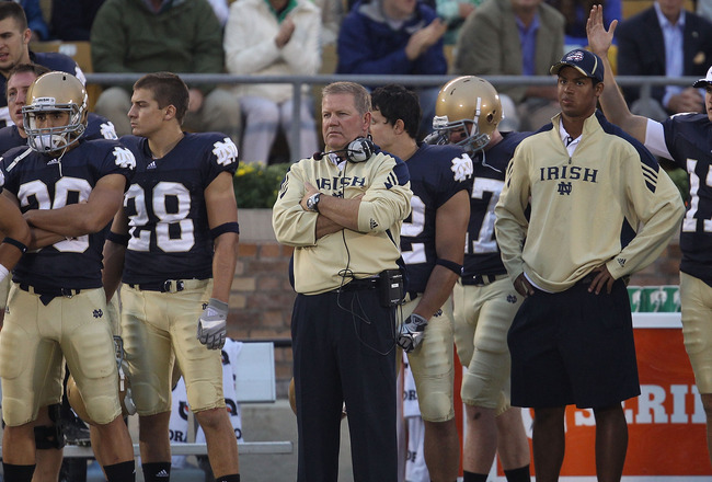SOUTH BEND, IN - SEPTEMBER 11: Head coach Brian Kelly of the Notre Dame Fighting Irish (center) watches as his team takes on the Michigan Wolverines at Notre Dame Stadium on September 11, 2010 in South Bend, Indiana. Michigan defeated Notre Dame 28-24. (P
