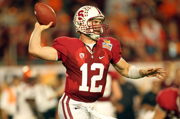 MIAMI, FL - JANUARY 03:  Andrew Luck #12 of the Stanford Cardinal throws pass against the Virginia Tech Hokies during the 2011 Discover Orange Bowl at Sun Life Stadium on January 3, 2011 in Miami, Florida. Stanford won 40-12. (Photo by Mike Ehrmann/Getty
