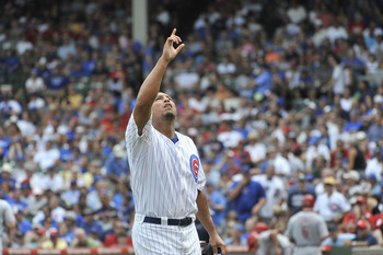CHICAGO, IL - AUGUST 06:  Starting pitcher Carlos Zambrano #38 of the Chicago Cubs points to the sky after finishing the sixth inning against the Cincinnati Reds at Wrigley Field on August 6, 2011 in Chicago, Illinois.  (Photo by Brian Kersey/Getty Images
